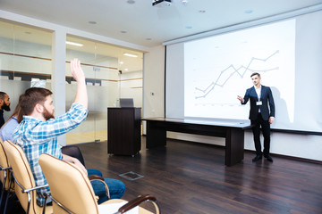 Confident speaker talking to audience on business training