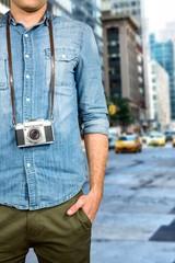 Composite image of hipster man holding digital camera