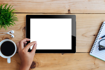 hand using mockup tablet on wood desk white display with clippin