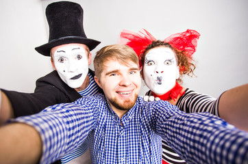 Funny couple of mimes taking a selfie photo,  April Fools Day concept