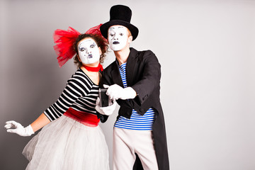 Funny couple of mimes taking a selfie photo,  April Fools Day