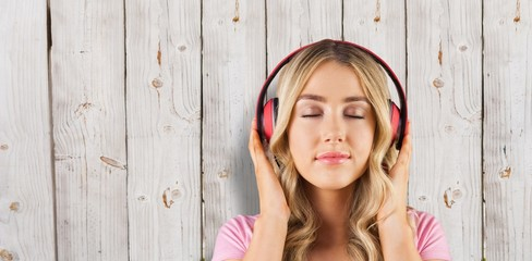 Composite image of close up of a woman listening to music