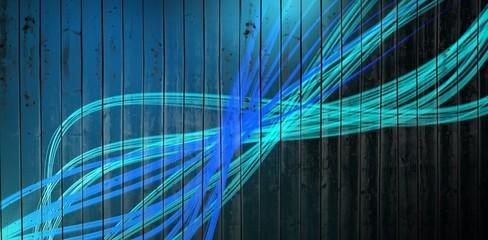 Composite image of curved laser light design in blue