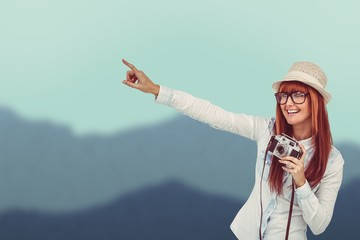 Composite image of attractive hipster photographing with camera