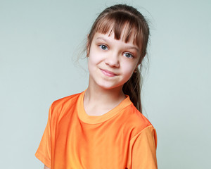 Joy, smile, emotions - portrait of a smiling young girl child in