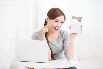 woman with calculator and laptop