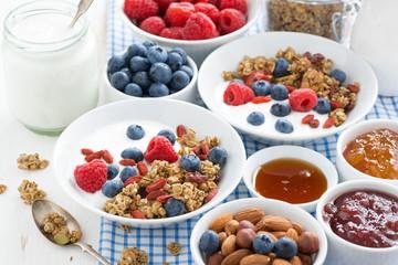 breakfast with granola, berries, honey and yogurt