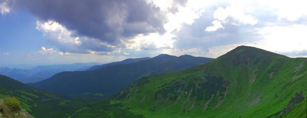 Green mountain ridge panorama, summer sunny day.