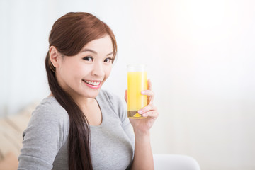 woman hold orange juice