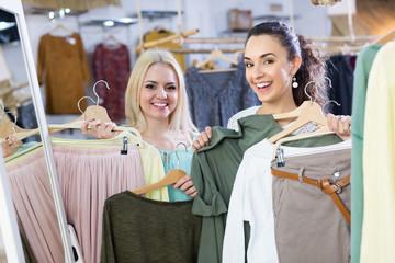 Smiling young women shopping