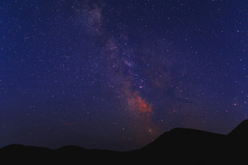 Vibrant night sky, milky way in mountains.
