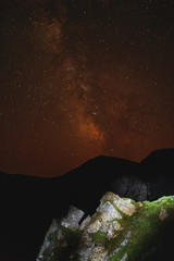 Night scene of mountain ridge and clear starry sky.