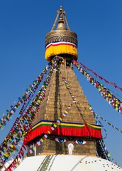 prayer flags and Bodhnath stupa in Kathmandu, Nepal