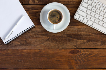 Office Composition with Electronics Stationery and Coffee on Hardwood