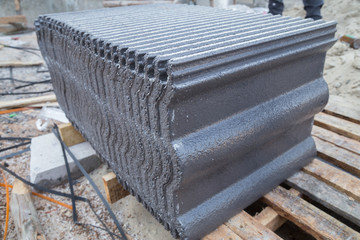 stack of concrete roof tile (gray color) at construction site