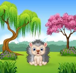 Cartoon funny hedgehog sitting in the jungle