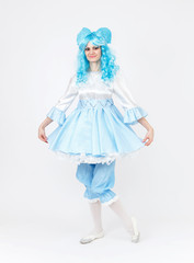 Theatre actress in fairy tale costume on white background