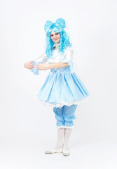 Theatre actress in fairy tale costume of alive doll on white