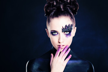 Young Woman Fashion Model. Makeup and Hairstyle
