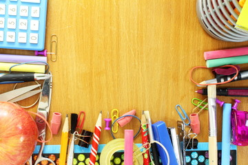 school supply on wooden desk