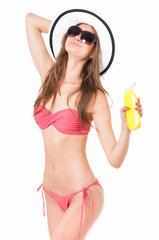 Woman in bikini applying cream for skin