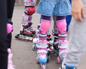 Children on the street in the Summer on roller skates