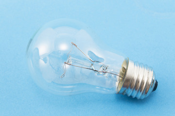 100 W light bulb on a blue background