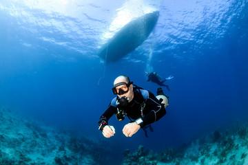 Canvas Prints Diving Sidemount SCUBA Diving below a dive boat