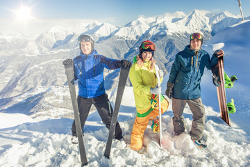 Ski and snowboard. Sport woman and man in snowy mountains