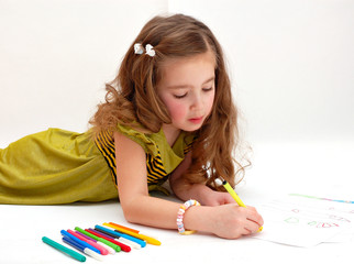 little girl drawing on light background