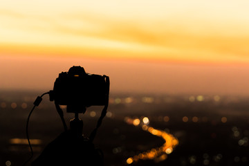 silhouette of camera at dusk.