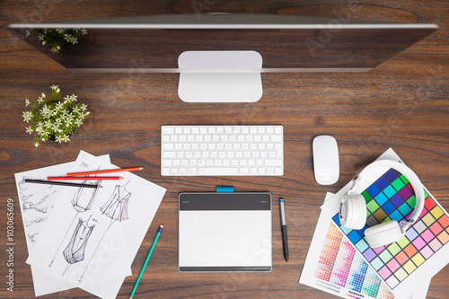 top view of a fashion designer workspace