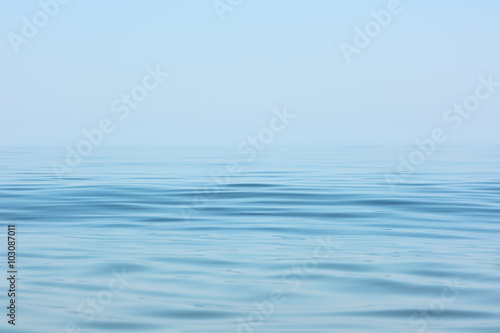 Fototapete Calm sea surface. Seascape in early morning hours under clear skies.