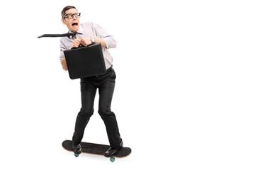 Scared businessman riding a skateboard