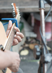 classical guitar player on street, selective focus