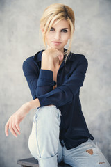 Beautiful blonde young woman in casual style. Fashion model