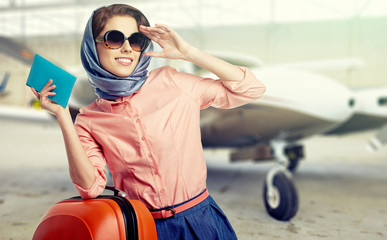 Vintage young female passenger at the airport (shallow DOF; colo