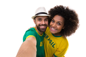 Brazilian couple taking a selfie photo on white background