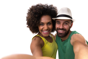 Brazilian couple taking a selfie photo on white background