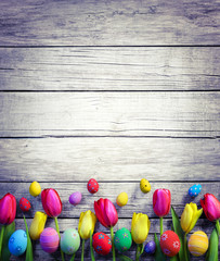 Tulips And Easter Eggs On Vintage Wooden