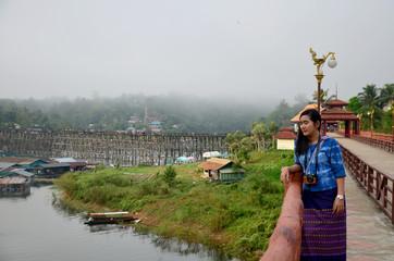 Thai woman travel and portrait on Saphan Mon wooden bridge in mo