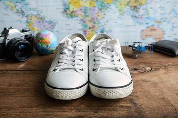 Canvas shoes with camera and map
