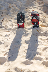 Flip flops in the sand