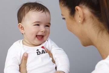 Laughing little boy with mother