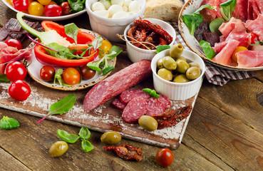 Appetizer set. Meat, vegetables on wooden board.