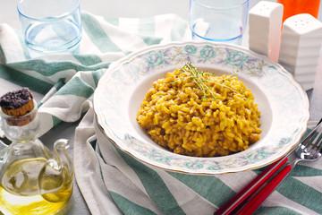 risotto alla Milanese with saffron . Healthy Italian food