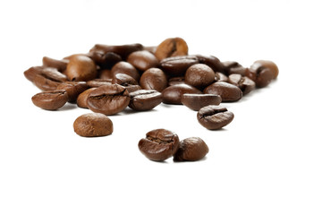 Group of coffee beans on a white background.