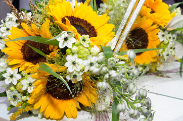 Bridal bouquet of flowers and sunflowers.