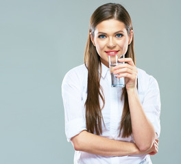 Beautiful woman white shirt dressed hold water glass.