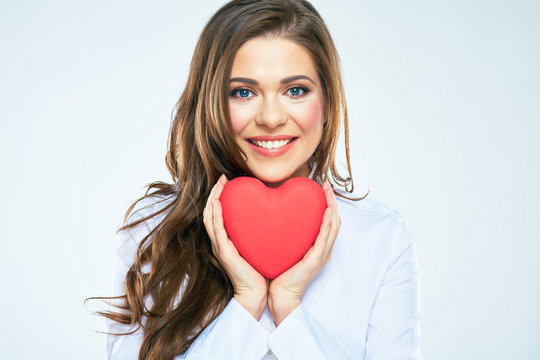 Red heart symbol of Valentines day smiling woman hold.